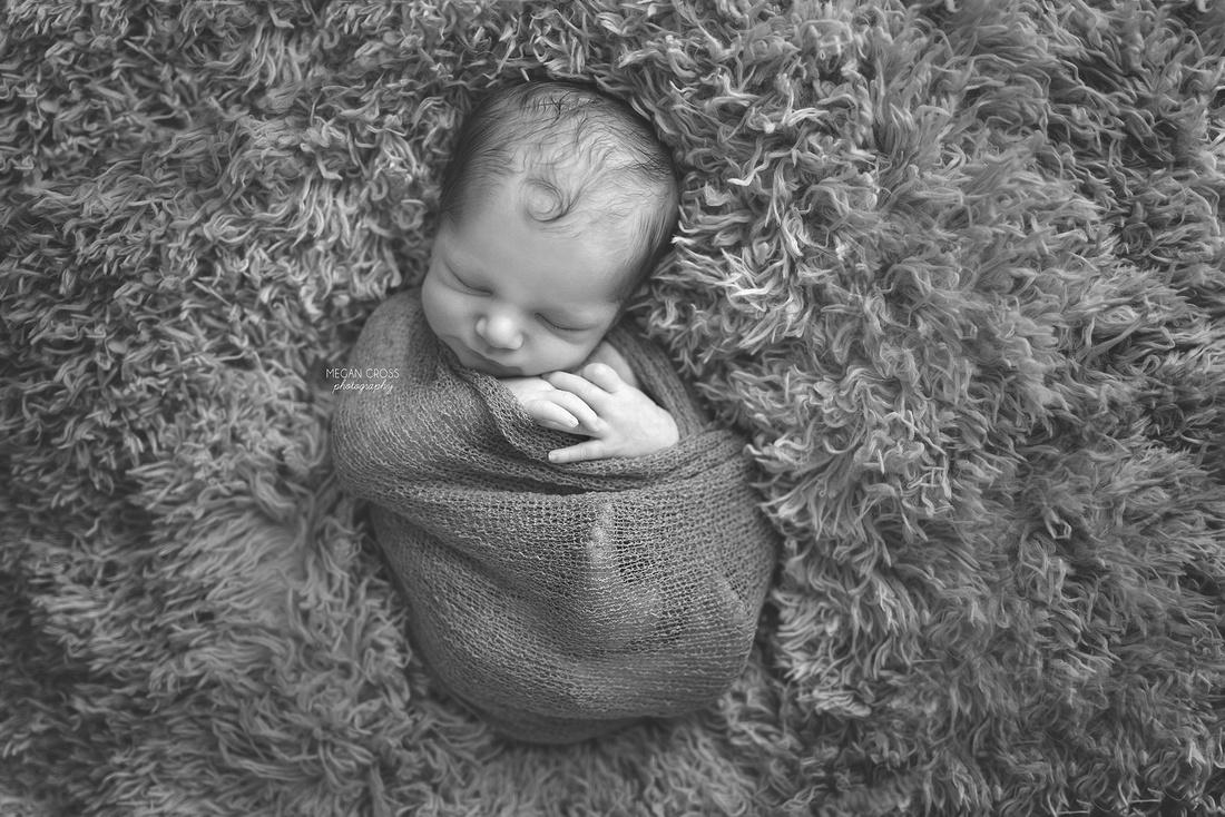 b&w wrapped baby